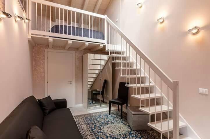 Camera doppia loft con divano letto  Double loft room with sofabed