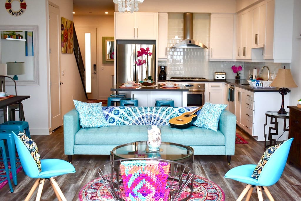 Open concept living room and kitchen welcome you.