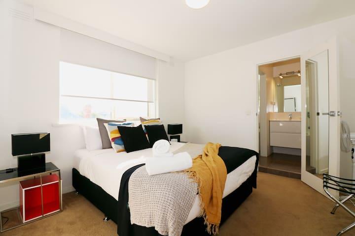 Spacious queen bedroom with ensuite