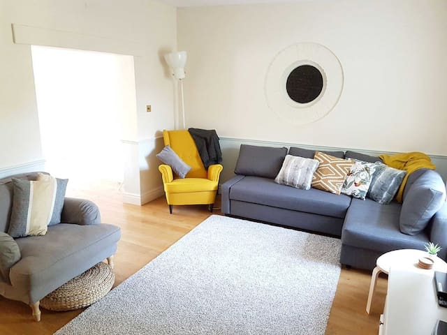 Spacious living room with double corner sofa bed.