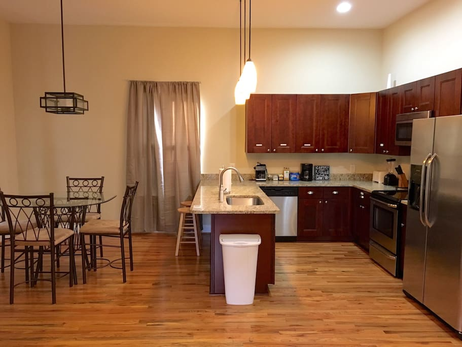 Gourmet kitchen, stocked with cookware, dishes, utensils and coffee