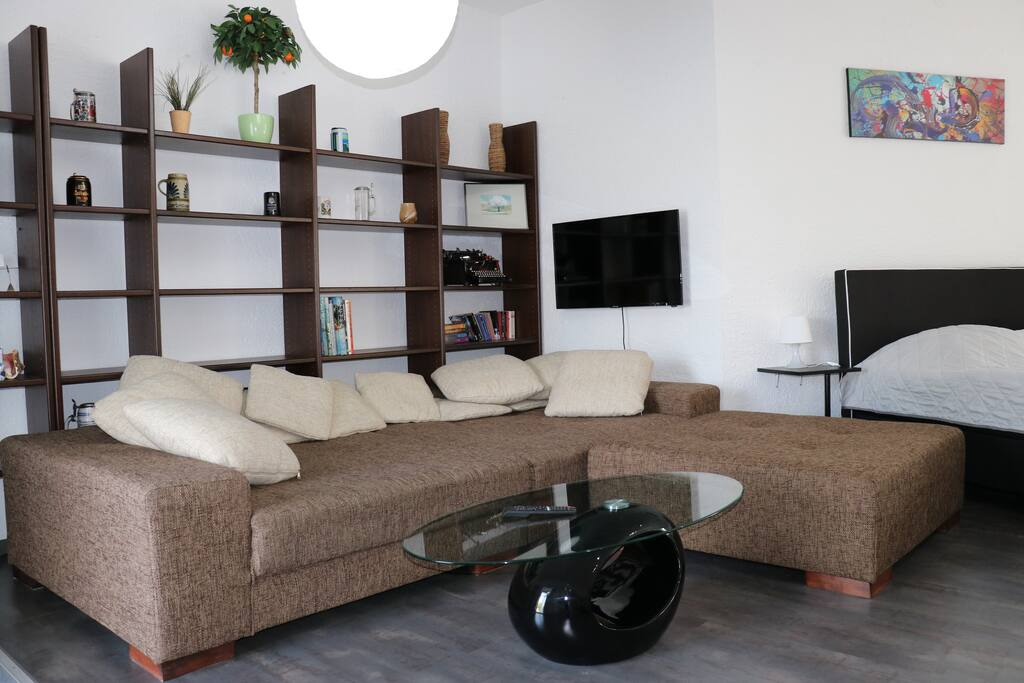 super cozy big sofa: in case you are a group of 5, one can sleep easily on the sofa and we make it a sofa bed