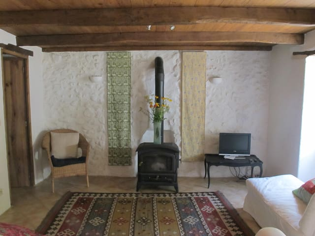 The living room has comfy sofas, a woodburner and tv/DVD.