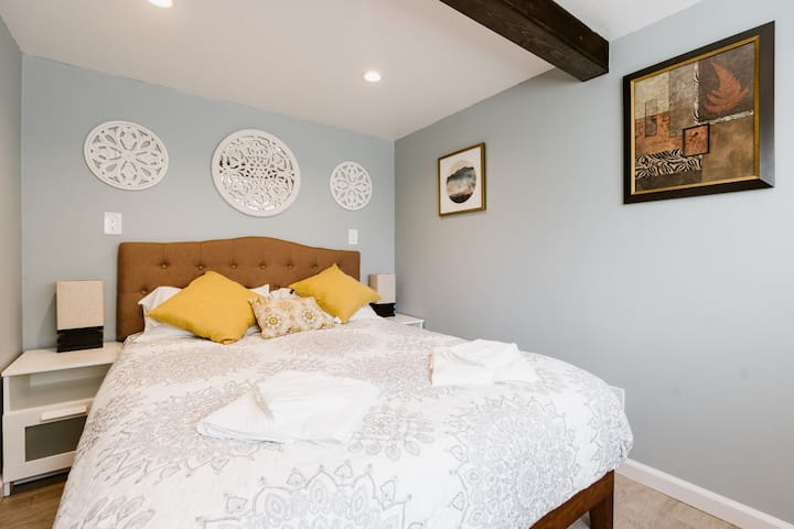The cozy bedroom offers a comfortable, new mattress for a good night's sleep.