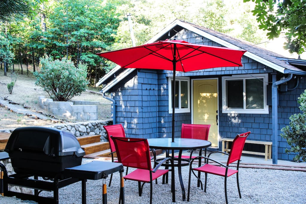 Side yard with bbq and table for four.