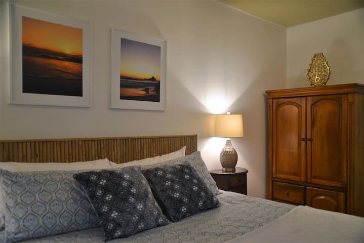 "Guests enjoy 4"" Memory Foam King Bed, private bathroom, AC, super fast WIFI and high quality linens & towels, all just steps from the beach"