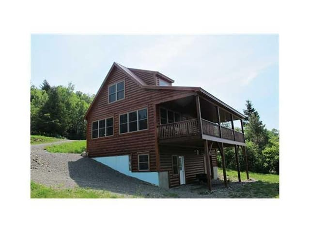 Beautiful home in the overlook with incredible views of Rangeley Lake