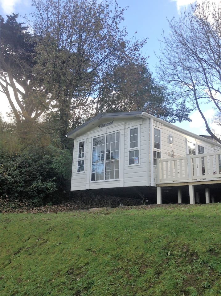 Beautiful caravan with sea views in a secluded woodland holiday park