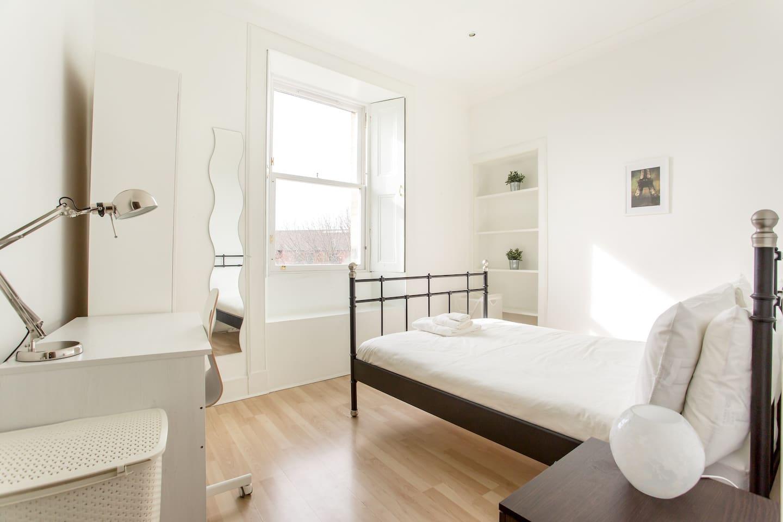 Bright master bedroom from the doorway