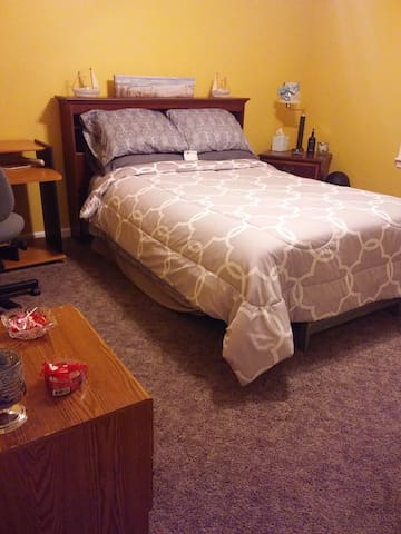 Extra-clean, spacious room with computer desk, small dresser, hanging shoe rack, nightstand with lamp, A/C and ceiling fan, bottled water, and extra-wide closet.  Stay connected for free... WiFi included!