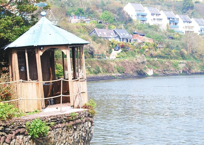 Driftwood hut by the sea... perfect spot to sit and watch the world go sailing by!