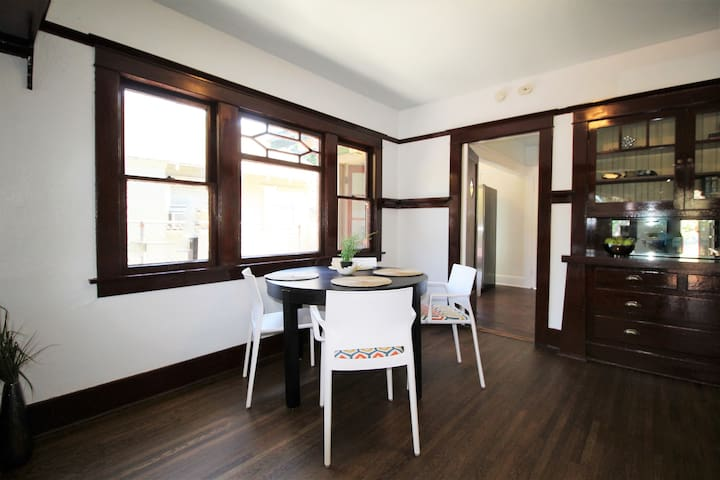 Dining area with built in cabinets and fantastic original wood trim! All upgraded throughout house!  Beautiful!