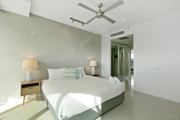 The master bedroom is fitted with a luxurious king-sized bed with a TV, ensuite bathroom, walk-in robe and balcony.