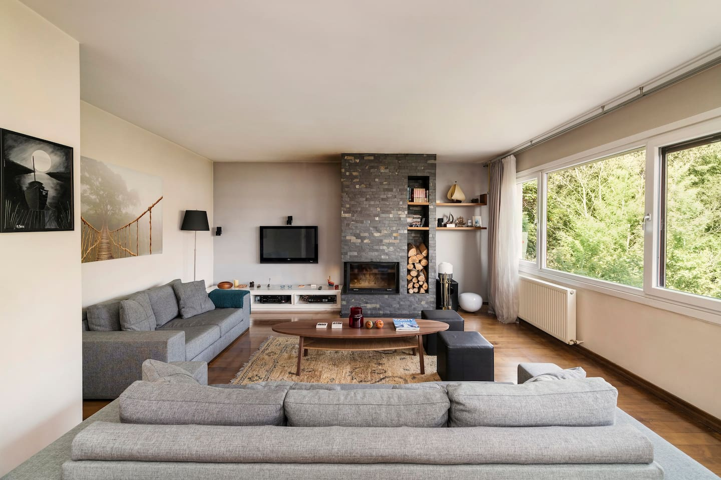 Spacious living room with a built in fire place and beautiful open views of the nature and Bosphorus.