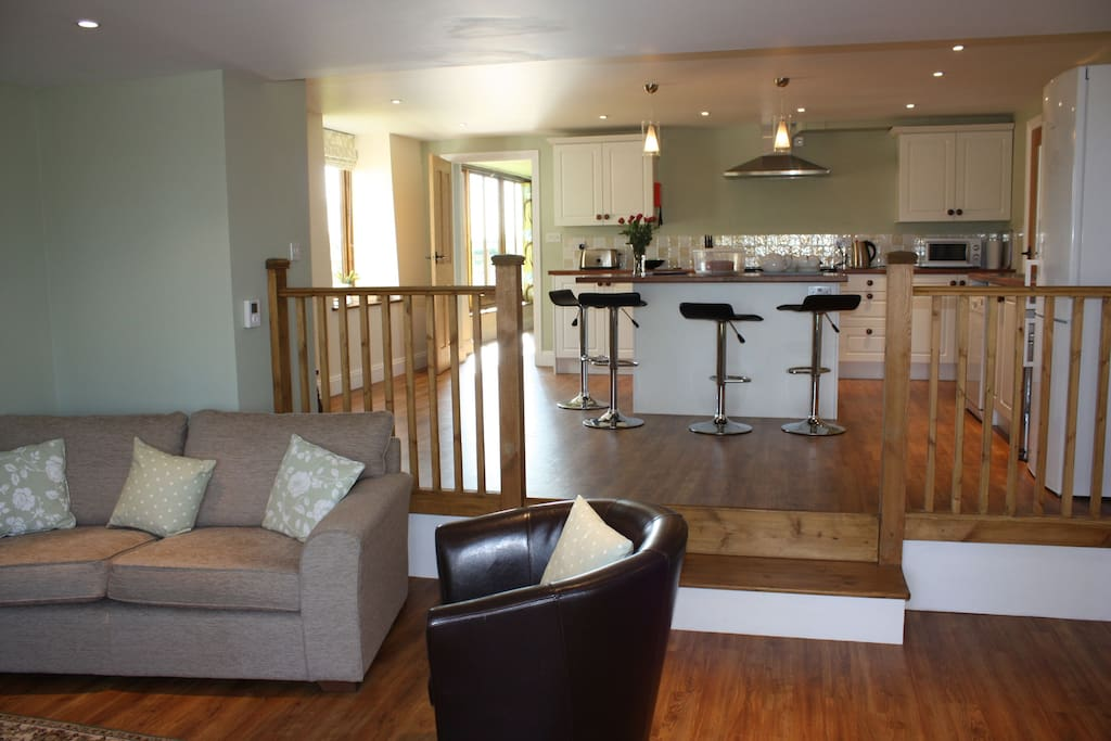 The open plan kitchen leading to the smaller sitting room