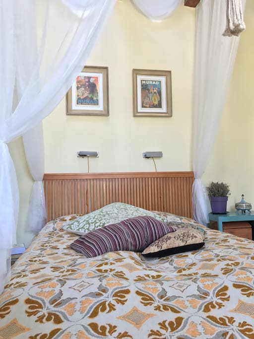The bed is a comfortable queen size canopy bed.