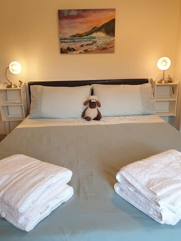 Bedroom 3: With a King-size bed with private en-suite. View of the dam wall and valley.