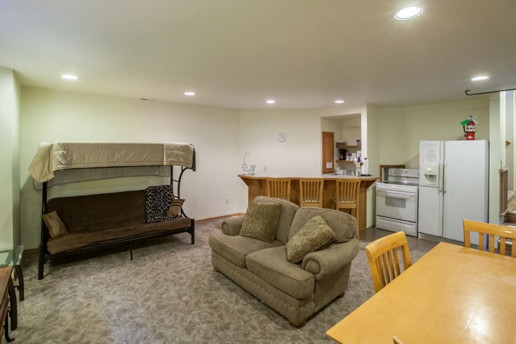A kitchen with full sized refrigerator, stove, microwave, toaster, coffee maker, plates, glasses, pots and pans is yours if you are tired of eating out every night.