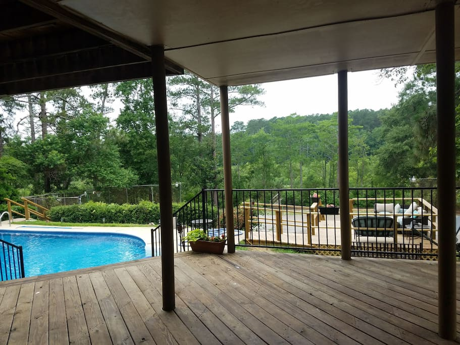 Lower level deck looking out towards pool and lake