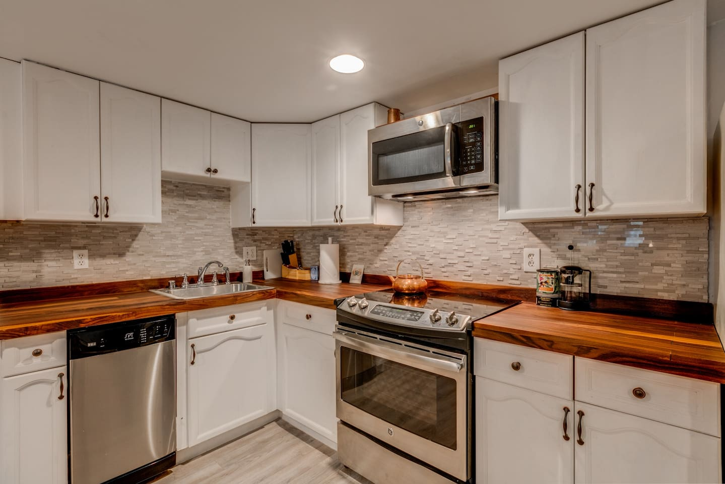 Fully equipped kitchen with handmade black walnut counter tops.