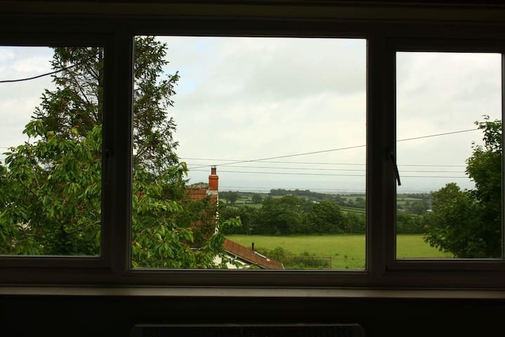 The view from the guest bedroom. You are looking towards Glastonbury and the Mendip Hills. Glastonbury is 4.5 miles away.