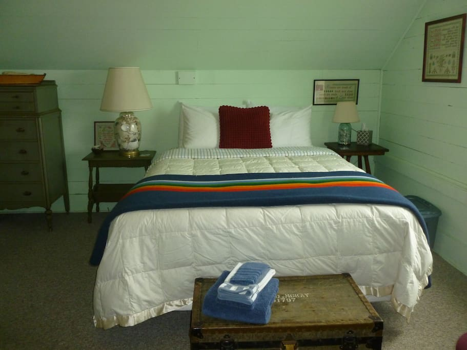 The Green Room is furnished with a QUEEN size bed, extra blankets & comfy pillows, a dresser, and closet storage space.
