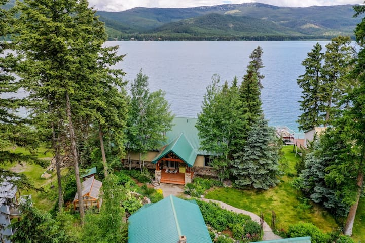 Lakefront home w/ private dock, mountain/lake views & wood stove!