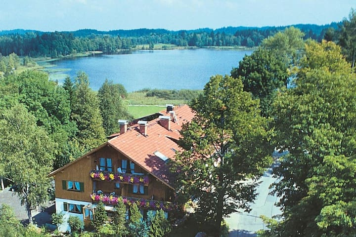 Cosy holiday home with balcony located directly by Soier See lake and the nature park/spa gardens