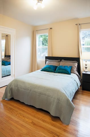 Bedroom with queen size Tempurpedic memory-foam mattress, Bluetooth alarm clock, thermal blackout curtains