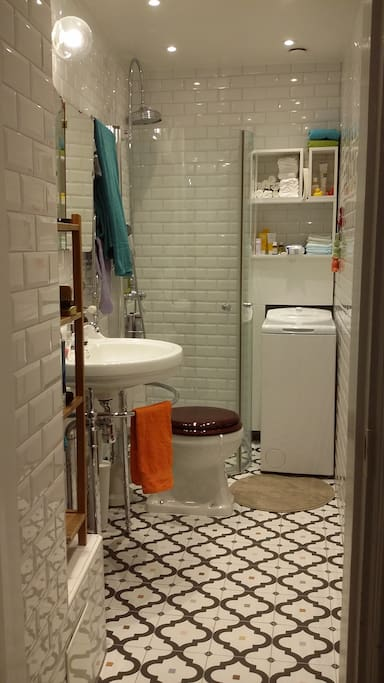 Newly renovated bathroom with shower, washing machine and floor heating.