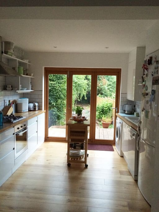Kitchen, opening onto deck and garden