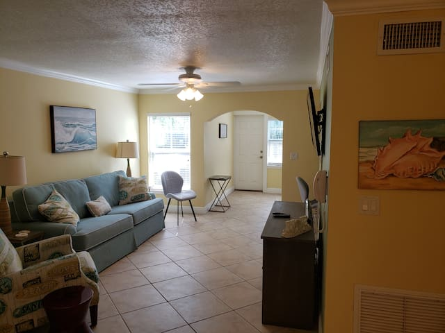 Living room area... Couch w/ pullout queen size bed... Recliner Chair... Wet Bar... Mounted TV... Desk