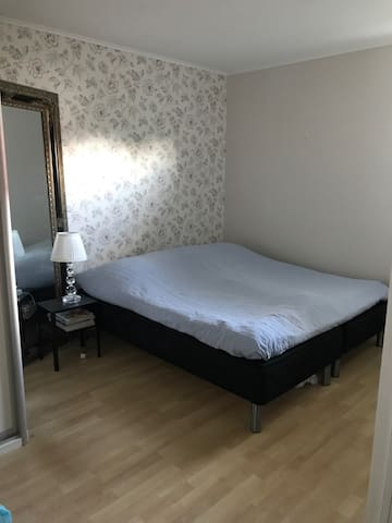 Kingbed in private bedroom with wardrobes.