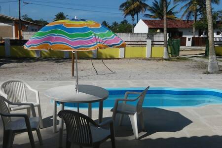 Casa em Condomínio Prado-BA