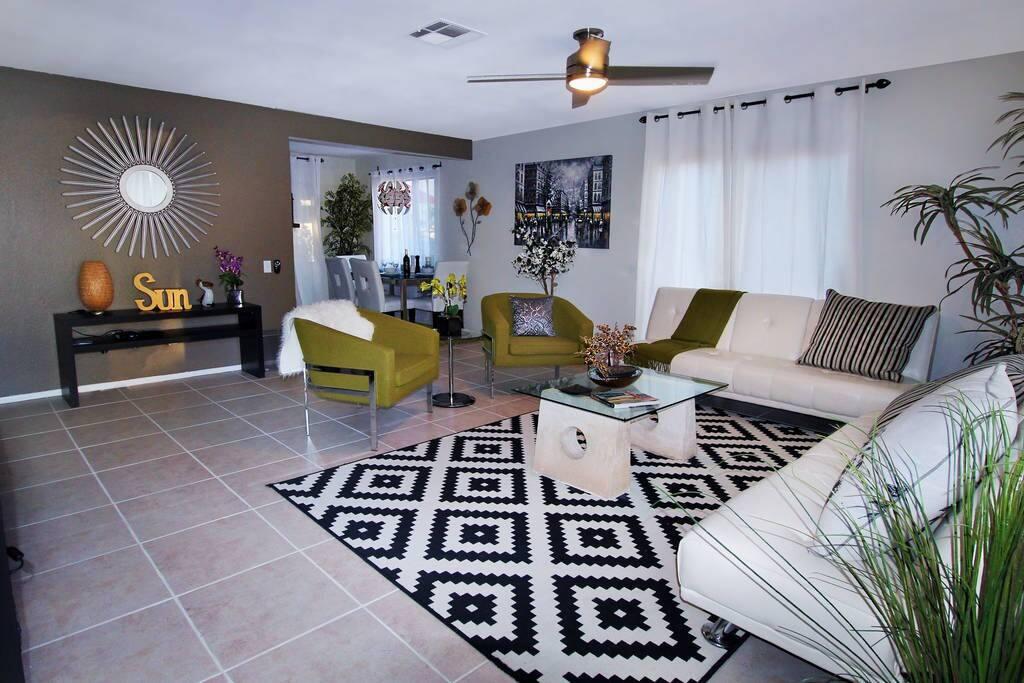 Living room includes 2 sofas/futon beds