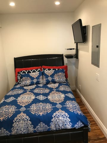 Queen size bedroom on the main floor with its private full bathroom.