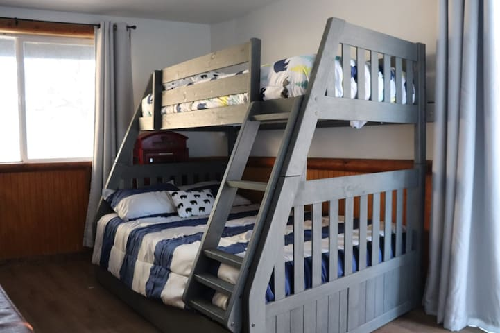 【1st floor - game room/2nd bedroom】 Bunk bed with twin and full mattress +  pull out twin trundle.