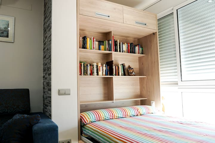 The bed, it can be turned inside the closet to have more space during the day.