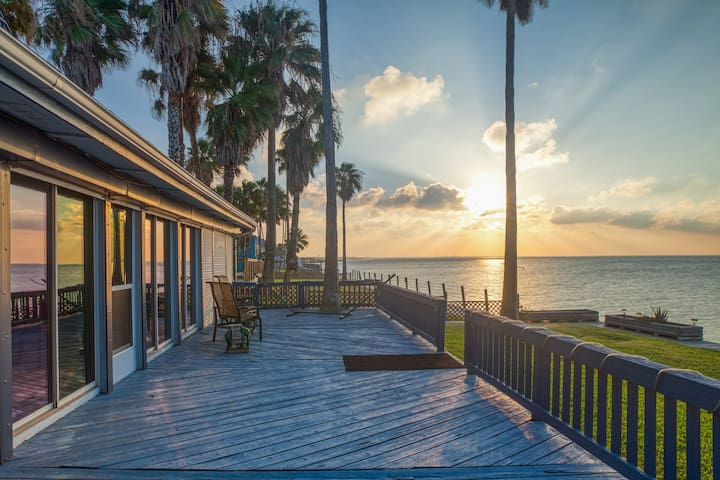 New listing! Charming bay front home w/deck, sunroom, pool table, and shared gym