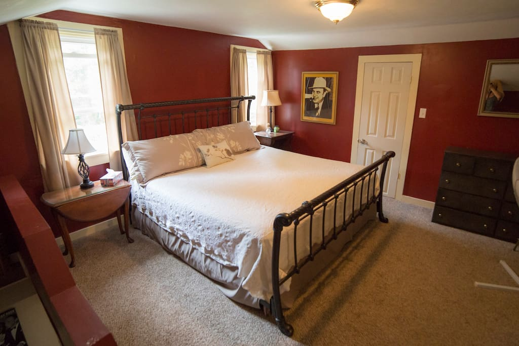 King size bed with TV in room, private stair case.