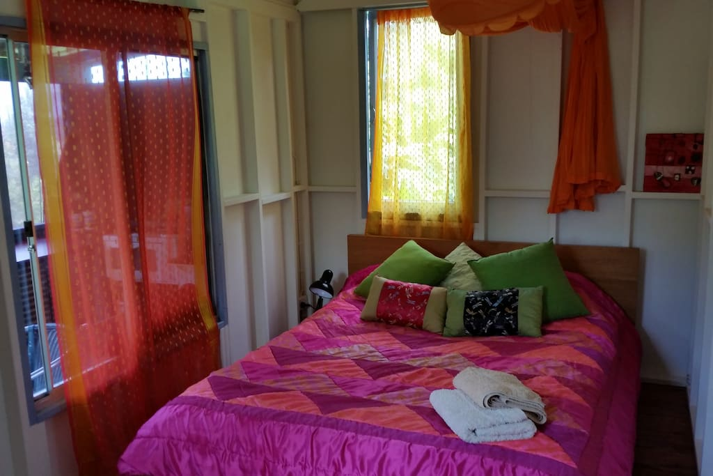 Colourful bedroom with good cross ventilation and afternoon sea breezes.