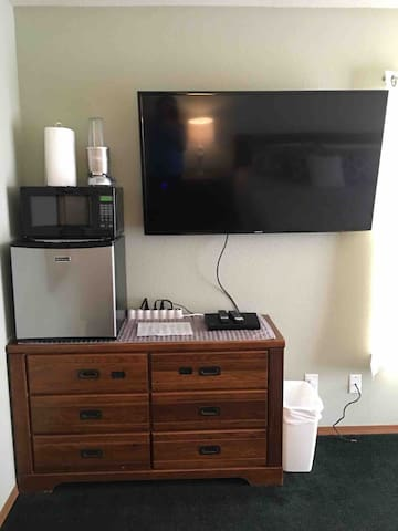 Microwave, small frig and large Smart TV with DBD player in room