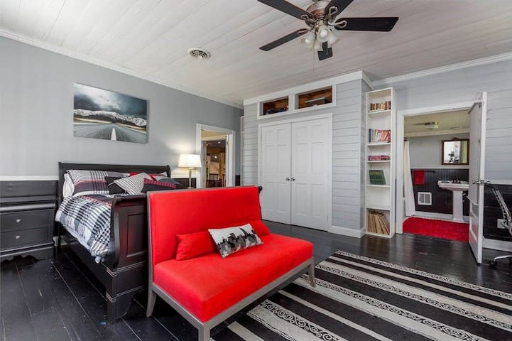 This stylish modern bedroom has a flatscreen TV with Amazon Fire Stick, and also opens up to the large waterfront balcony outside.