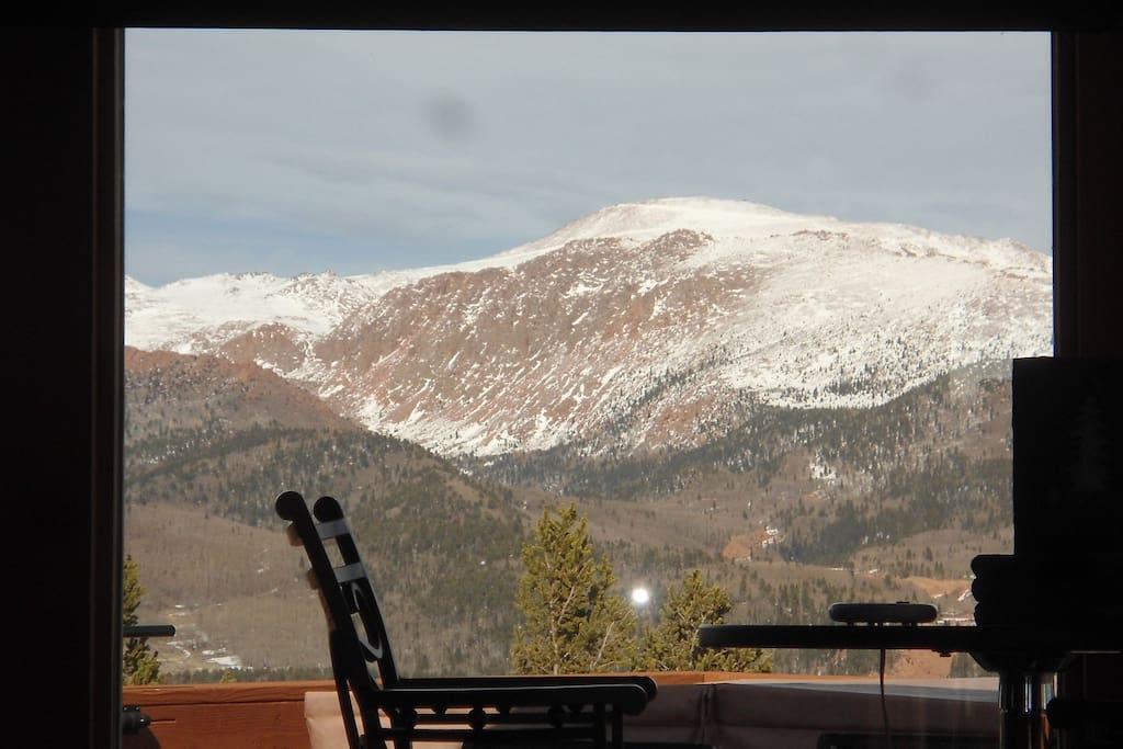 Pikes Peak summit from the Great Room sofa.  The bistro table is in the foreground.