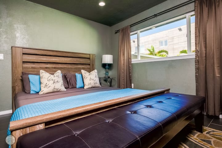 The Master Bedroom with private en suite.  Personal AC unit to assure your comfort is met nightly.  King Size bed with memory foam mattress and pillows to bury yourself in.