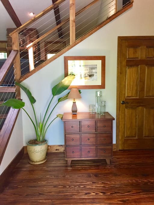 This is the entry foyer of our home. The door to the Waterfall Apartment is pictured on the right.