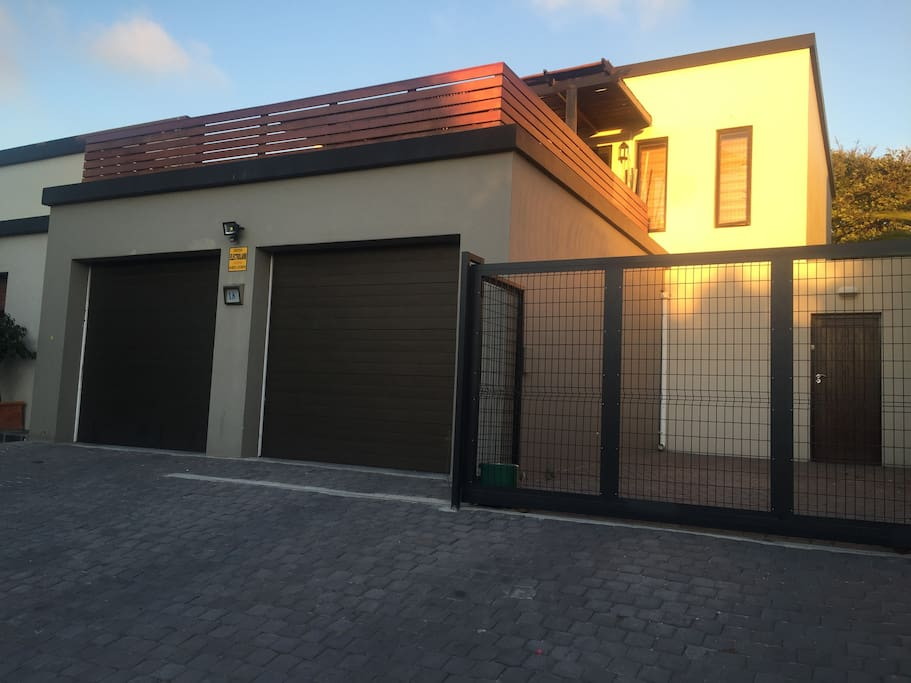 Apartment on right hand side and top deck - secure parking behind automated gate