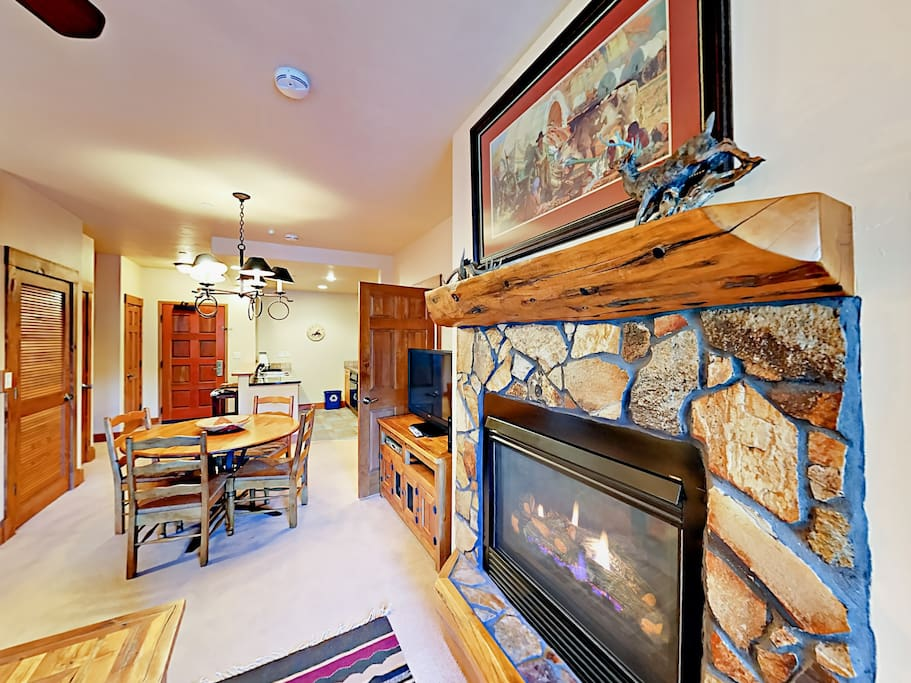 Pretty stone-surround gas fireplace for extra warmth in the living area.