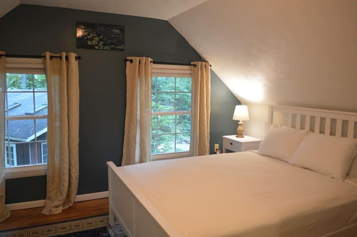 Master bedroom upstairs with queen bed