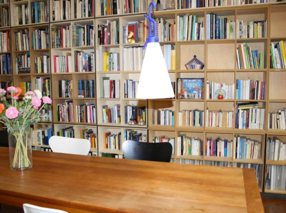 Living room with art, dining table and book shelf